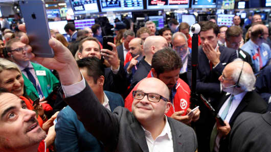 Jeff Lawson, (C) Founder, CEO, & Chairman of Communications software provider Twilio Inc., takes a selfie photo during his company's IPO on the floor of the New York Stock Exchange (NYSE) in New York City, U.S., June 23, 2016.