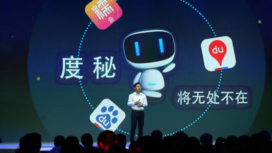 Robin Li, founder, chairman and CEO of Baidu, introduces the new AI-powered digital assistant 'Duer' during the 2015 Baidu Technology Innovation Conference on September 8, 2015 in Beijing, China.