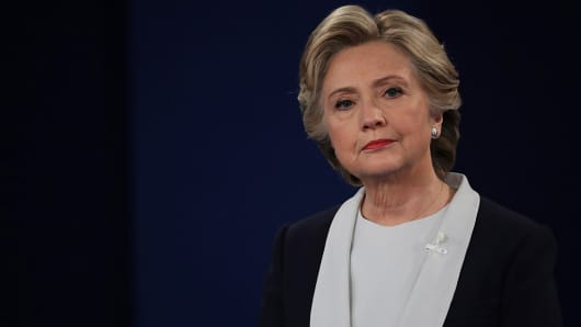 Democratic presidential nominee former Secretary of State Hillary Clinton listens to a question during the town hall debate at Washington University on October 9, 2016 in St Louis, Missouri.