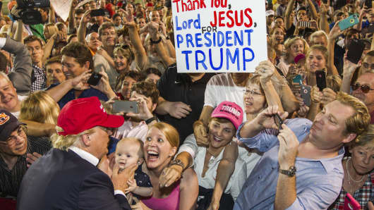 Republican presidential candidate Donald Trump greets supporters after his rally at Ladd-Peebles Stadium on August 21, 2015, in Mobile, Alabama.