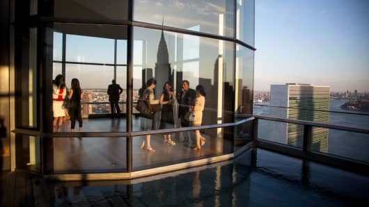 Guests attend a pool party in a penthouse apartment in New York.