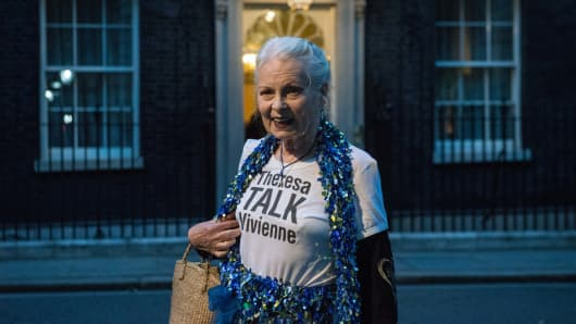 Vivienne Westwood wears a 'Theresa Talk Vivienne' t-shirt when arriving for a celebration of British fashion hosted by British Prime Minister Theresa May