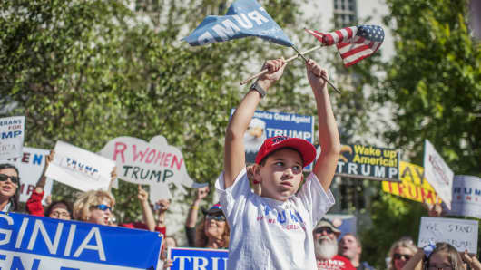 Supporters of Republican presidential candidate DonaldTrump rally outside of the Republican National Committee headquarters on Capitol Hill, October 10, 2016.