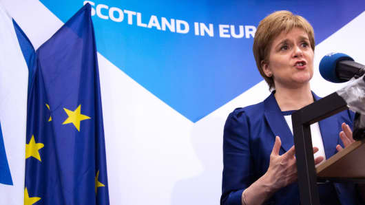 Scotland's First Minister Nicola Sturgeon delivers a speech during a media conference at the Scotland House in Brussels as she is on a one day visit to meet with EU officials, on June 29, 2016.