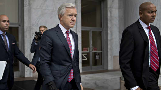 John Stumpf, chief executive officer of Wells Fargo & Co., center, exits the Rayburn House Office building after a House Financial Services Committee hearing in Washington, D.C., U.S., on Thursday, Sept. 29, 2016.