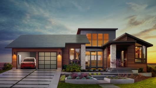 Tesla displays integrated solar roof and Powerwall product for individual use