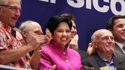 Indra K. Nooyi, CEO of PepsiCo., rings the opening bell with other executives at the New York Stock Exchange.