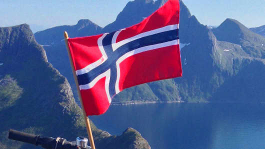 Flag of Norway on the island Senja, near Tromsø in Northern Norway.