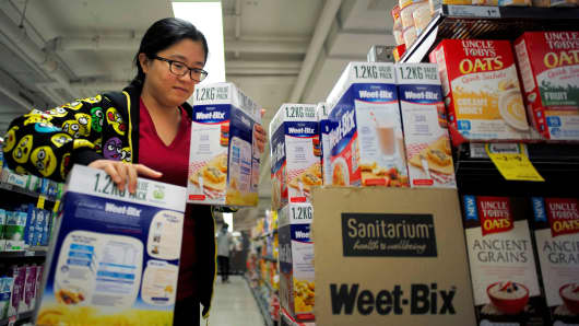 Chinese shopping agent Na Wang selects Sanitarium's Weet-Bix cereal biscuit, during a shopping trip for Chinese customers at an Australian supermarket in Sydney on August 2, 2016.