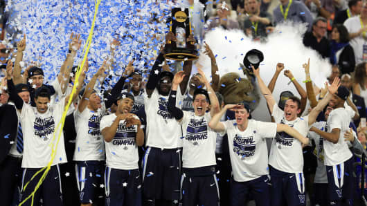 The Villanova Wildcats celebrate after defeating the North Carolina Tar Heels 77-74 in the 2016 NCAA Men's Basketball National Championship on April 4, 2016 in Houston, Texas.