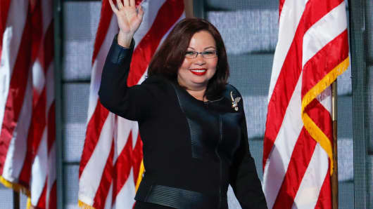 Rep. Tammy Duckworth, D-Ill., waves to delegates during the final day of the Democratic National Convention in Philadelphia , Thursday, July 28, 2016.