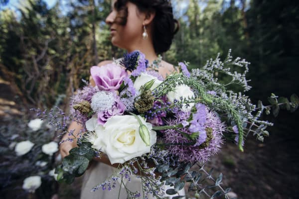 "A Colorado bride shows off her ""smokeable"" bouquet."