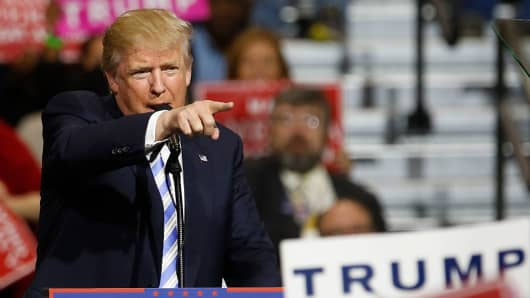 Republican presidential candidate Donald Trump addresses supporters during a campaign rally in Cleveland, Ohio on October 22, 2016.
