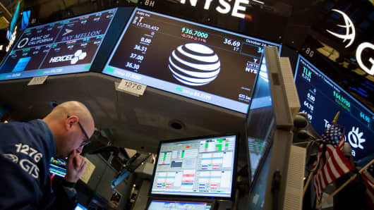 AT&T revenues dip as wireless equipment sales slide