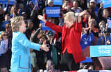 Democratic presidential nominee Hillary Clinton and Senator Elizabeth Warren hold a rally at St. Anselm College in Manchester, NH on Oct. 24, 2016.