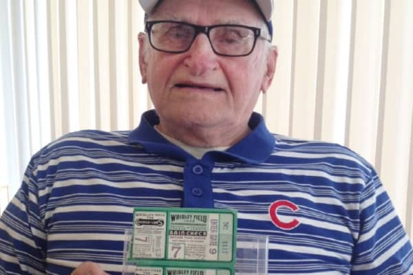 World War II veteran 97-year-old Jim Schlegel last watched his Cubs play in the World Series in 1945, but a donation from CNBC's Marcus Lemonis is getting him to Wrigley Field this time around.