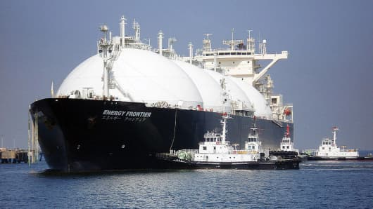 A liquefied natural gas (LNG) tanker arrives at a gas storage station.