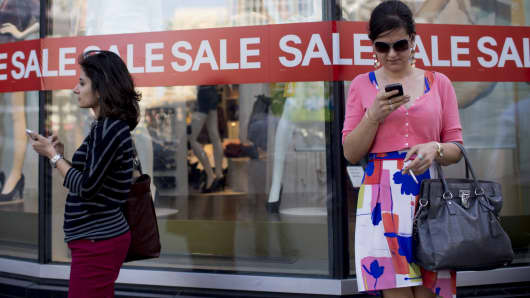 Women on their phone, shopping