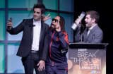 Honorees Rus Yusupov (L) and Colin Kroll (R) accept the Breakthrough Award for Emerging Technology from rapper Lil Jon (C) onstage at the Variety Breakthrough of the Year Awards during the 2014 International CES at The Las Vegas Hotel & Casino on January 9
