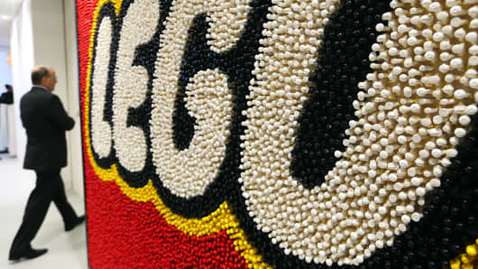 A visitor passes a giant Lego logo
