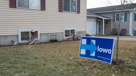 A campaign sign for Democratic presidential candidate, Hillary Clinton is seen on a lawn on January 31, 2016 in West Burlington, Iowa.