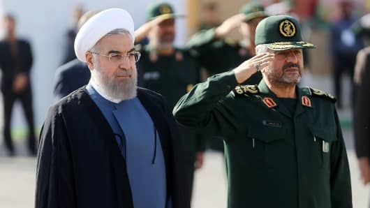 Iranian President Hassan Rouhani (left) and IRGC Major General Mohammad Ali Jafari
