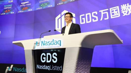 GDS Holdings rings the opening bell at the Nasdaq site in New York, November 2, 2016.