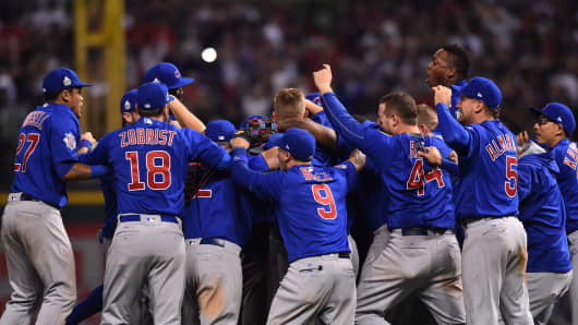 Chicago Cubs players celebrate on the field after defeating the Cleveland Indians in game seven of the 2016 World Series at Progressive Field.
