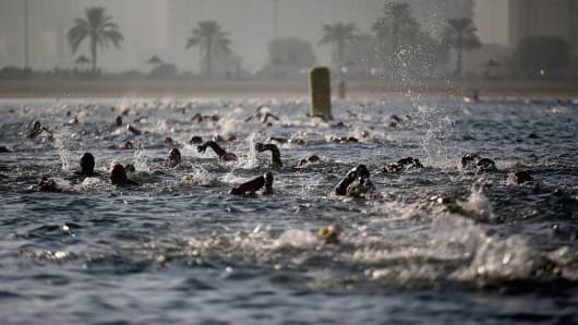 Swimmers in the ocean, swimming