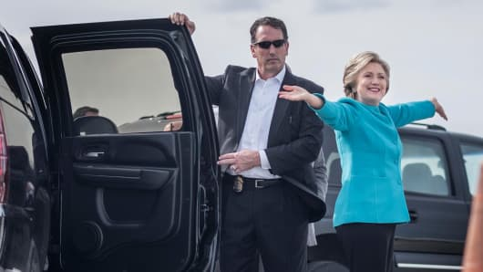 n her 69th birthday with arms wide open, Democratic Nominee for President of the United States former Secretary of State Hillary Clinton boards her campaign plane bound for a day of Florida campaigning in Miami, Florida Tuesday October 26, 2016.