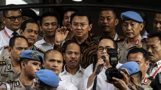 Governor of Jakarta Basuki Tjahaja 'Ahok' Purnama (C) speaks to journalists after a police investigation in Jakarta on Nov 7, 2016.