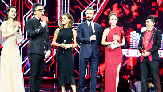 David Beckham (C) and his wife Victoria Beckham (third from left) attend the 2016 Tmall 11:11 Global Shopping Festival gala in Shenzhen, Guangdong province.