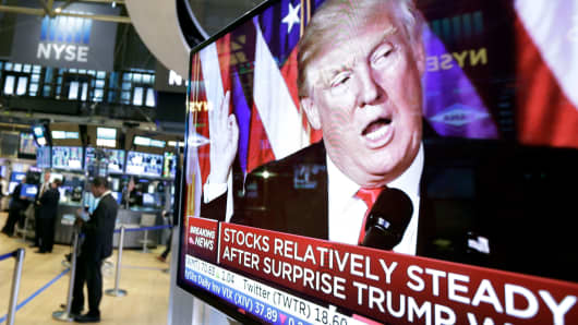 An image of President-elect Donald Trump appears on a television screen on the floor of the New York Stock Exchange, Wednesday, Nov. 9, 2016.