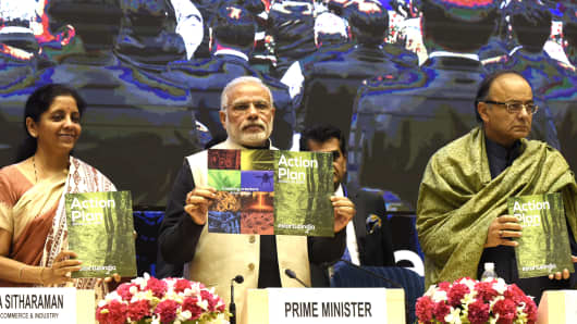 Prime Minister Narendra Modi (C), Finance Minister Arun Jaitley (R) and Minister of States for Independent Charge Nirmala Sitharaman releasing the Action Plan at the launch of Start-Up India at Vigyan Bhavan on January 16, 2016