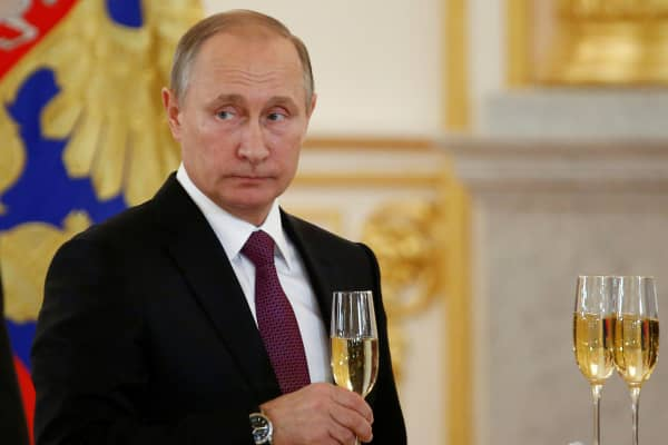 Russia's President Vladimir Putin holds a glass during a ceremony of receiving diplomatic credentials from foreign ambassadors at the Kremlin in Moscow, Russia, November 9, 2016.
