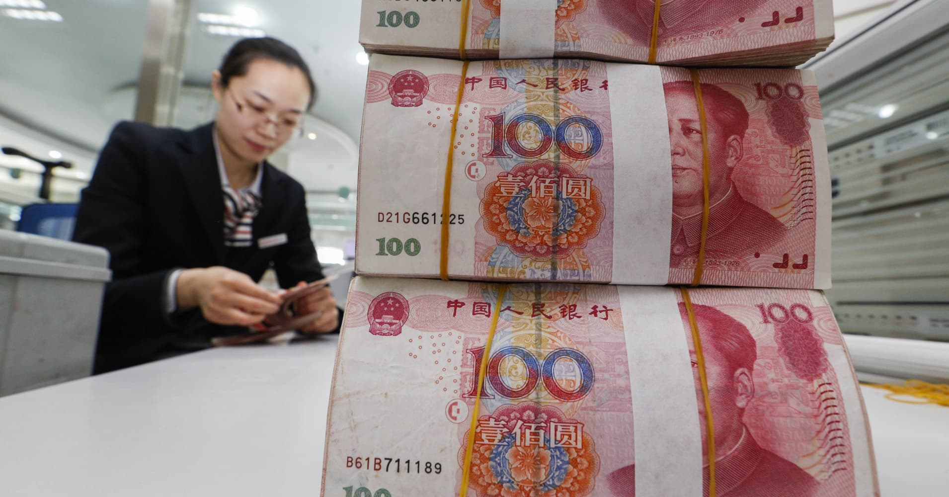 China's yuan tumbles to nearly eight-year lows as dollar jumps after US election