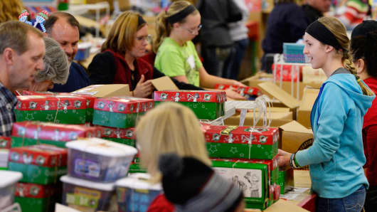 Hundreds of volunteers at the Denver Processing Center in Aurora, fill thousands of shoe boxes with toys and school supplies to be distributed to children around the world through Samaritan's Purse and Operation Christmas Child.