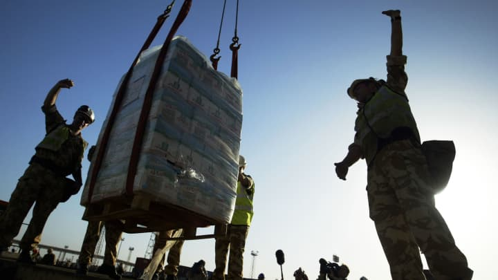 A pallet of fresh bottled water is lowered onto the dock from the British relief ship HMS Sir Galahad March 28, 2003 in Umm Qasr, Iraq. The British supply ship is the first shipment to arrive in Iraq.