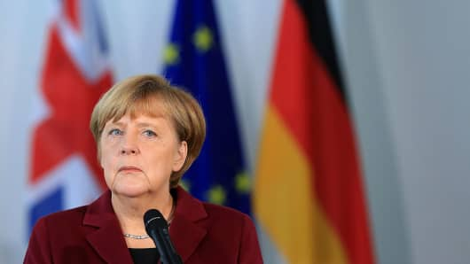 Angela Merkel, Germany's chancellor, looks on during a news conference with U.K. Prime Minister Theresa May at the Chancellery in Berlin, Germany, on Friday, Nov. 18, 2016.