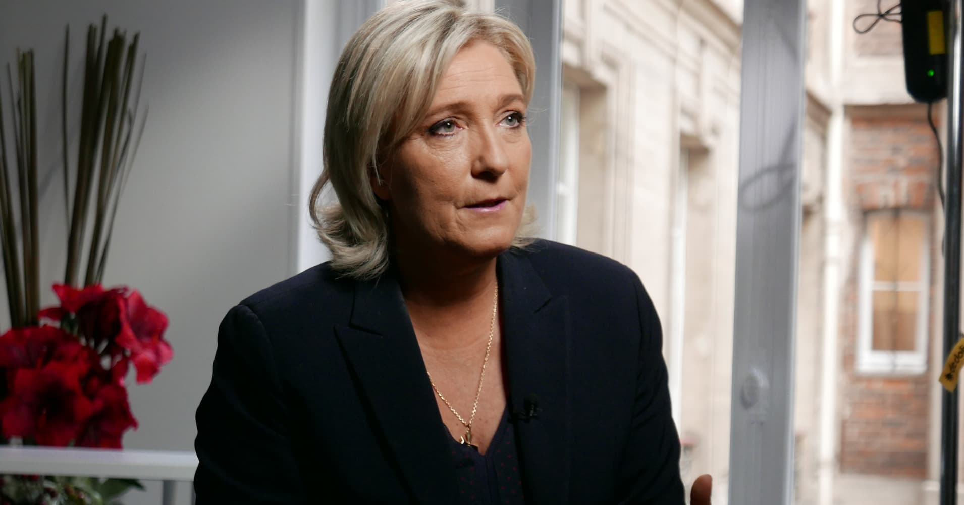 France's Le Pen says euro exit 'wouldn't be chaos'