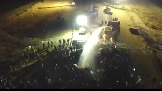 Authorities spray water over Dakota Access Pipeline protesters in freezing temperatures Sunday night, Nov. 20, 2016.