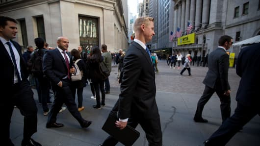 Pedestrians walk past the New York Stock Exchange (NYSE) in New York.