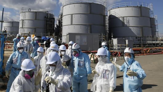 Members of the media at Tepco's tsunami-crippled Fukushima Daiichi nuclear power plant in Fukushima Prefecture in February 2016.