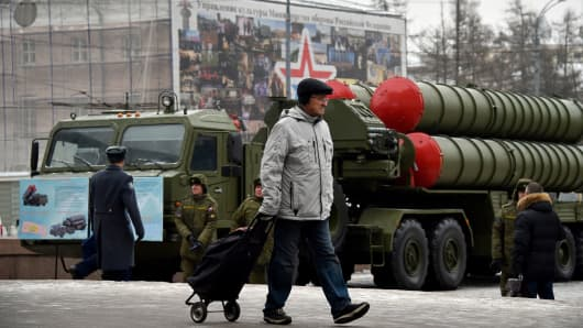 A man walks past a Russian surface-to-air missile system S-400 displayed on Suvorovskaya square in central Moscow on December 8, 2014 to mark the 100th anniversary of the Air Defence Forces.