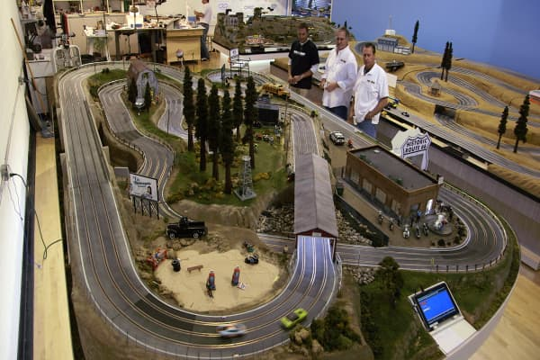 David Beattie (center) and employees test a replica track at Slot Mods headquarters in Charter Township of Clinton, Michigan.