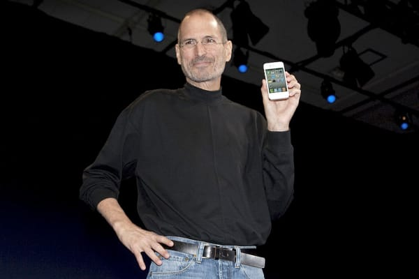 Steve Jobs, chief executive officer of Apple Inc., unveils the iPhone 4 during his keynote address at the Apple Worldwide Developers Conference (WWDC) in San Francisco, California, U.S.
