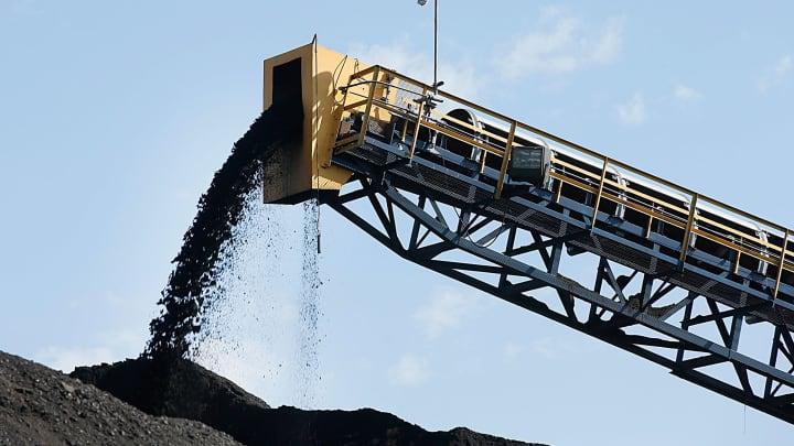 Coal falls off a conveyer belt at the Savage Energy Terminal in Price, Utah.
