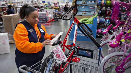 An employee tags an item for store pickup, a program where customers select and pay for items online for pickup, at a Wal-Mart location in Chicago.