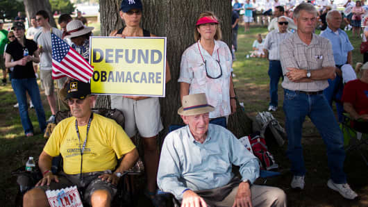 The Tea Party holds an Exempt America from Obamacare rally on Capitol Hill in Washington.