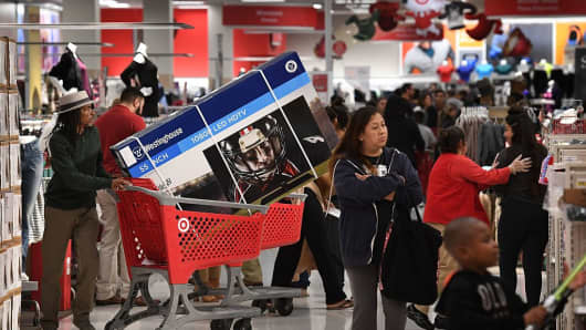 Thanksgiving Day shoppers push loaded up carts during the 'Black Friday' sales at a Target store in Culver City, California on November 24, 2016.